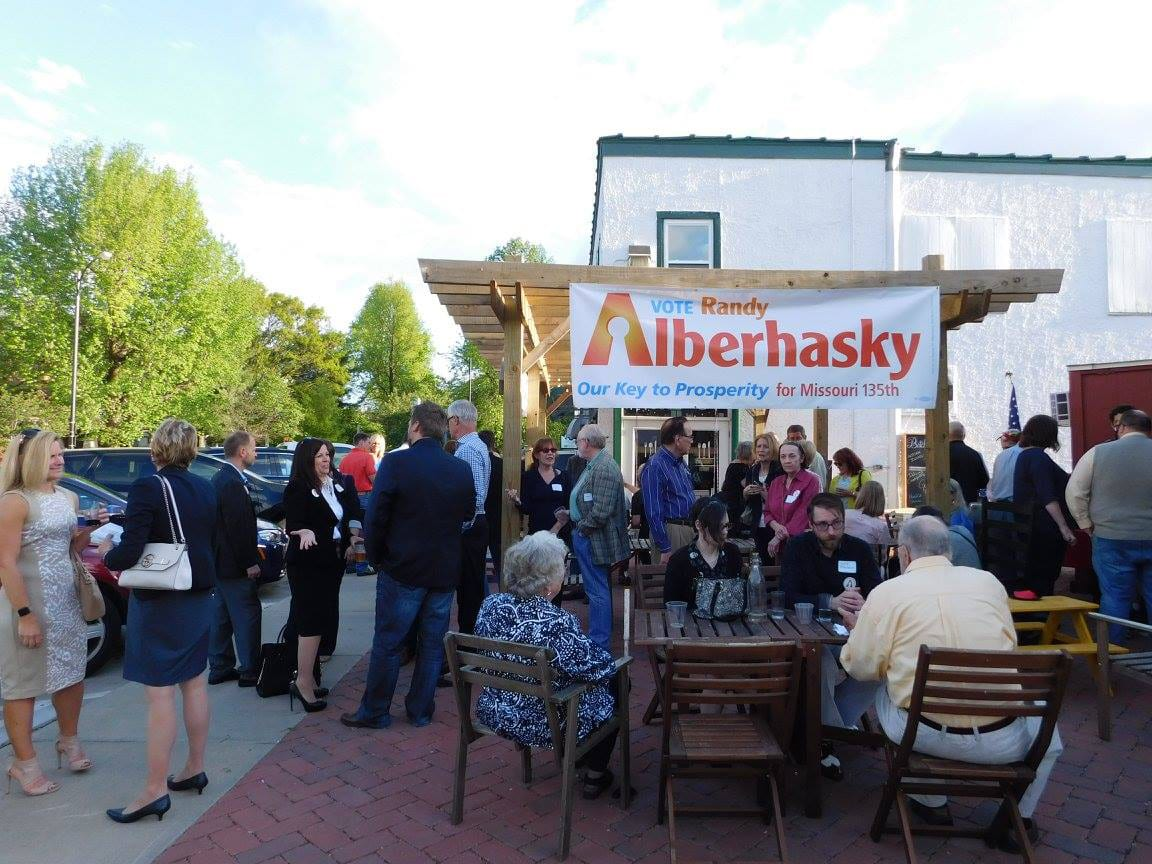 Vote Randy Alberhasky event on outdoor brick patio with large crowd