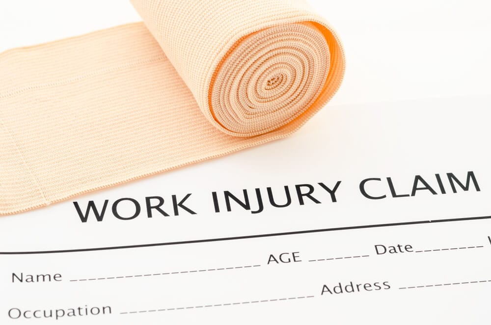 Close up of Work Injury Claim form and bandage roll
